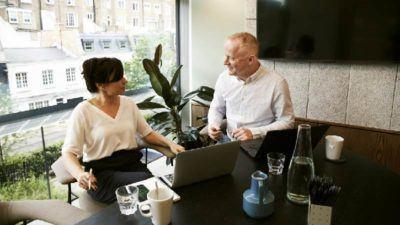Man and women having conversation in boardroom